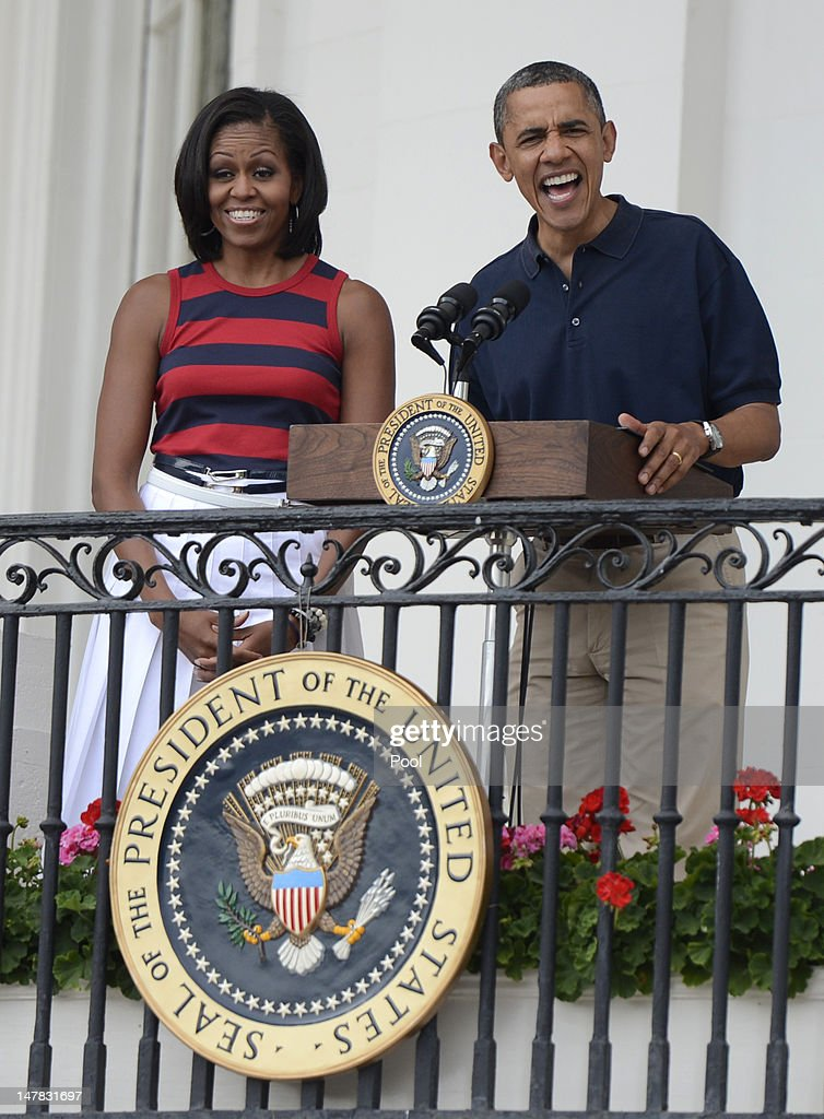 U.S. President Barack Obama, with first lady Michelle Obama delivers remarks to an Independence Day picinic on the South Lawn of the White House on July 4, 2012 in Washington, D.C. On this Independence Day President Obama is hosting a 4th of July celebration picnic on the South Lawn for White House staff and US service members.