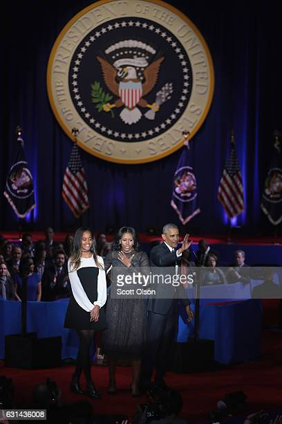 President Barack Obama with his wife Michelle and daughter Malia greets the crowd the crowd following his farewell speech to the nation on January 10...