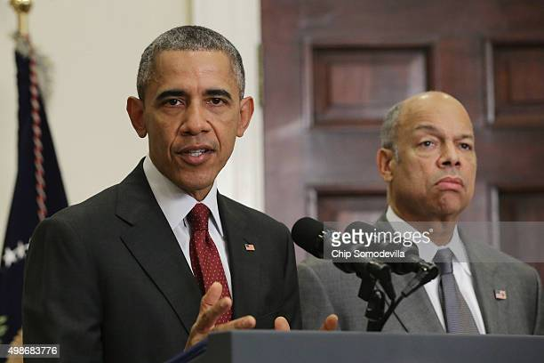 S President Barack Obama with Homeland Security Secretary Jeh Johnson delivers a statement in the Roosevelt Room following a national security...