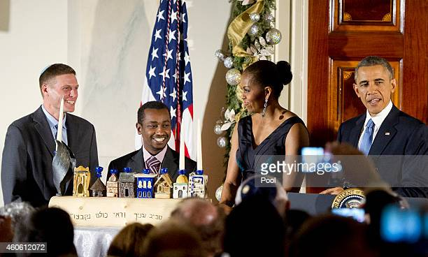 S President Barack Obama with Michelle Obama makes remarks at the second of two Hanukkah receptions with Dr Adam Levine Assistant Professor of...