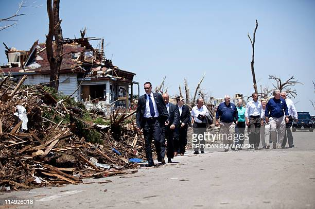 US President Barack Obama with Missouri Governor Jay Nixon tours tornadodamaged Joplin Missouri on May 29 2011 Victims of the tornado continue to...