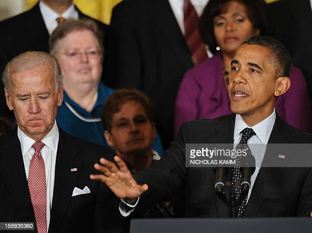 President Barack Obama, with Vice President Joe Biden , speaks on the economy in the East Room of the White House in Washington on November 9, 2012....