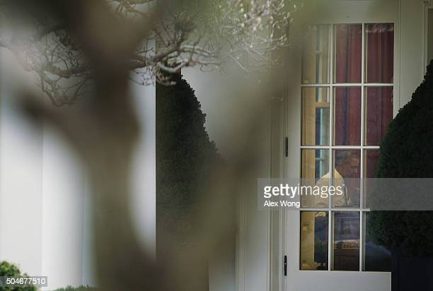 S President Barack Obama works at his desk in the Oval Office at the White House January 12 2016 in Washington DC President Obama will give his 7th...