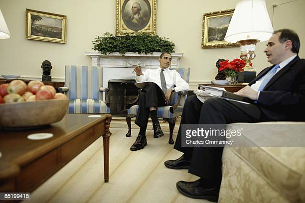 President Barack Obama works with Jon Favreau Ben Rhodes and David Axelrod on his address to the Joint Session of Congress in the Oval office of the...