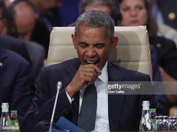 S President Barack Obama yawns as he attends the meeting of the North Atlantic Council at the Warsaw NATO Summit on July 8 2016 in Warsaw Poland NATO...