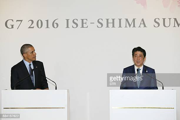 US President Barack Obamalooks on as Japanese Prime Minister Shinzo Abe speaks after a bilateral meeting during the Group of Seven summit meetings in...