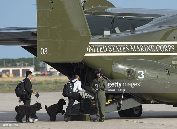 US President Barack Obama's dogs Bo and Sunny board a US Marine Osprey helicopter to travel from Cape Cod Coast Guard Air Station to Martha's...