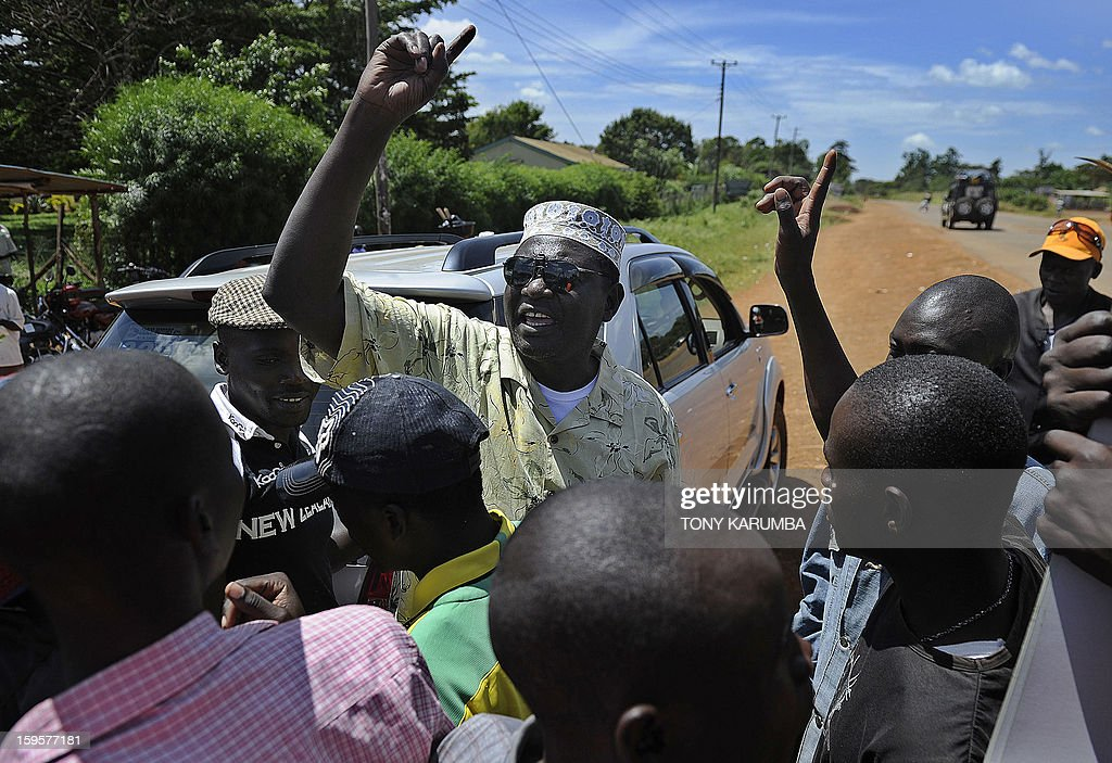 President Barack Obama's Kenyan half brother, Malik Obama (C) rallies supporters on January 16, 2013 near Nyang'oma in Kogelo, now renowned as the Obama's traditional home. Malik has launched his own political career by announcing his intention to run for a Kenyan gubernatorial seat in the upcoming March 4 general elections. Malik, 54, who shares a father with the US president told AFP that the achievements of his more famous half brother have 'inspired and challenged' him to get into active politics in his homeland. The trained economist said he is the right candidate to deal with the 'endless cycle of poverty and unemployment that bedevils my people.' . AFP PHOTO/Tony KARUMBA