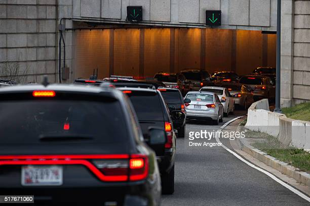 S President Barack Obama's motorcade gets slowed down in heavy traffic entering the 12th Street tunnel on the way back to the White House March 26...