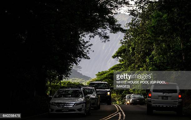 President Barack Obama's motorcade is seen departing for his vacation rental at Kailuana Place after hiking the Na Pohaku O Hauwahine trail off of...