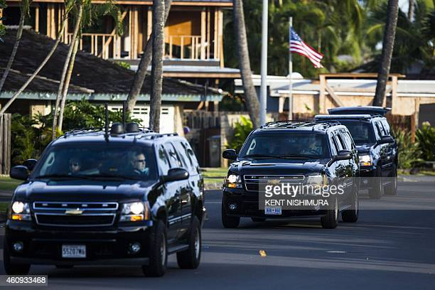 President Barack Obama's motorcade is seen heading to Marine Corps Base Hawaii on December 31, 2014 in Kailua, Hawaii. The First Family is...