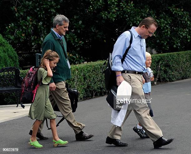 US President Barack Obama's White House Press Secretary Robert Gibbs Gibbs' fiveyearold son Ethan National Security Council Director of Strategic...