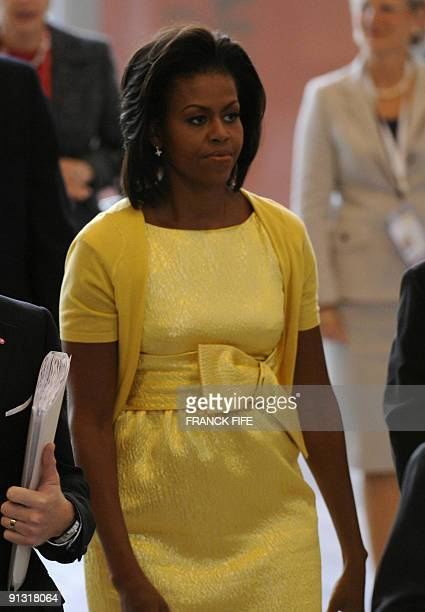 President Barack Obama's wife Michelle arrives ahead of presentations by delegations of the four cities bidding for a chance to host the 2016 summer...