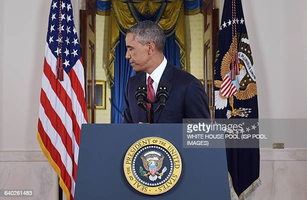 US President Barack turns away from the lectern after delivering a prime time address from the Cross Hall of the White House on September 10 2014 in...
