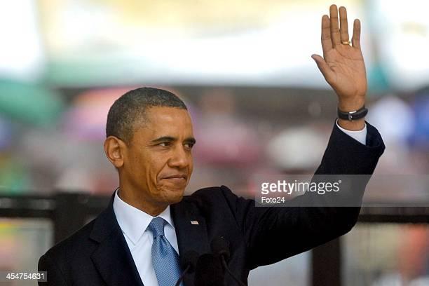 President Barak Obama attending Nelson Mandela's public Memorial Service at the FNB stadium on December 10 in Johannesburg, South Africa. The Father...
