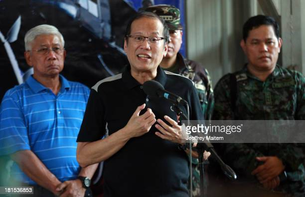 President Benigno Aquino III answers question from the media minutes before he departs for Manila from Zamboanga Philippines as the fighting...