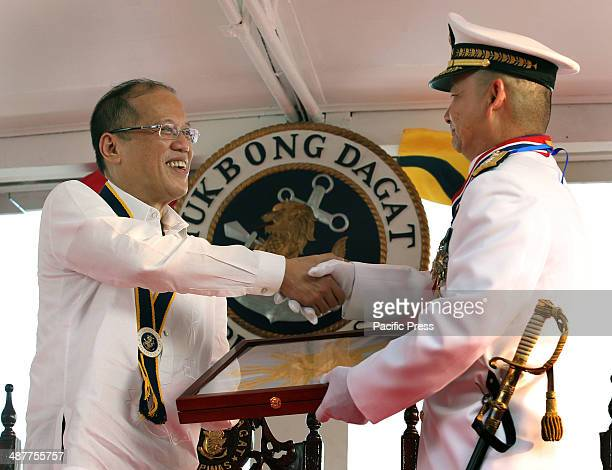 President Benigno S Aquino III presents the Command Plaque Plaque of Honorable Service Plaque of Appreciation Medal Frame and Philippine Flag to...