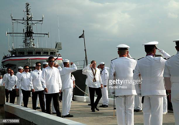 President Benigno S Aquino troops the line upon arrival for the PN Change of Command and Retirement Ceremony at the Capt Salvo Pier in Sangley Point...