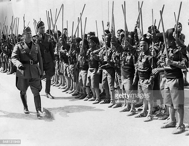 President Benito Mussolini in Benghazi in front of members of the state youth organization 'Opera Nazionale Balilla' attendant the general secretary...