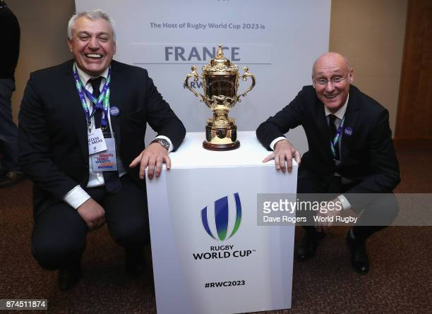 President Bernard Laporte poses with the Webb Ellis Cup with Claude Atcher the France 2023 bid chairman after the annoucement that France will host...