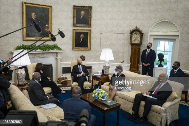 President Biden, center, speaks during a meeting with members of the congressional Black caucus in the Oval Office of the White House in Washington,...