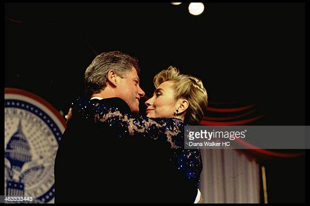 President Bill and Hillary Rodham Clinton are photographed dancing cheektocheek onstage at Kennedy Ctr inaugural ball for Time Life on January 20...