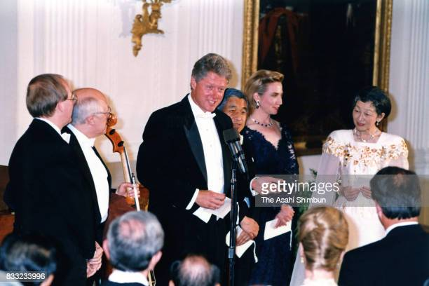 US President Bill Clinton addresses while Emperor Akihito Empress Michiko and Hillary Clinton listen after the music concert following the state...