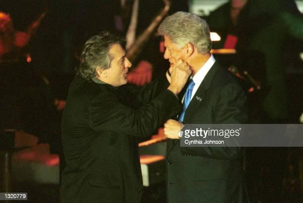 President Bill Clinton and actor Robert Deniro goof around at Hillary Clinton''s birthday bash fundraiser at the Roseland Ballroom October 25 2000 in...