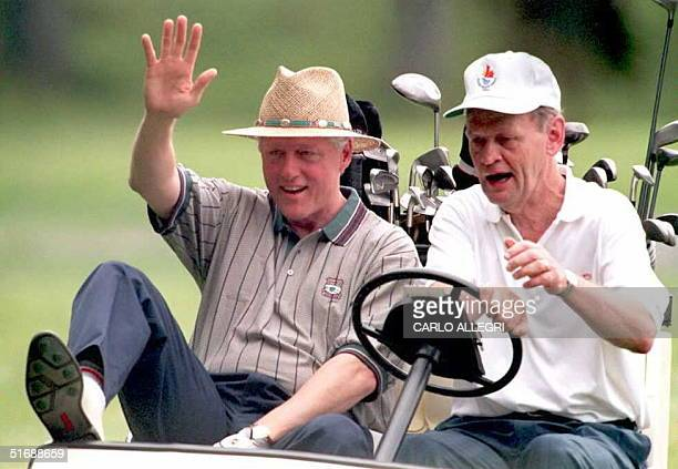 President Bill Clinton and Canadian Prime Minister Jean Chretien ride in a golf cart at the Ashburn Country Club in Halifax 17 June while playing a...