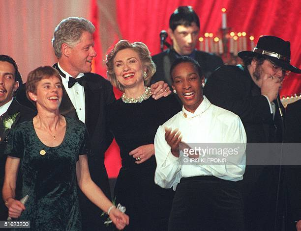 President Bill Clinton and First Lady Hillary Clinton along with Special Olympics athletes Rita Lanslor and Loretta Claiborne dance during ceremonies...
