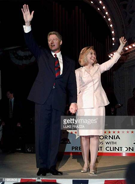 President Bill Clinton and First Lady Hillary Clinton appear at a rally 16 October in Balboa Park in San Diego California after Clinton debated...