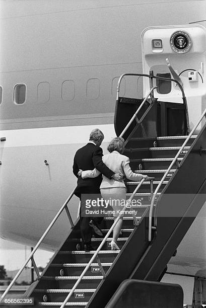 President Bill Clinton and First Lady Hillary Clinton board Air Force One on July 26 1996 at JFK International Airport following a briefing and press...