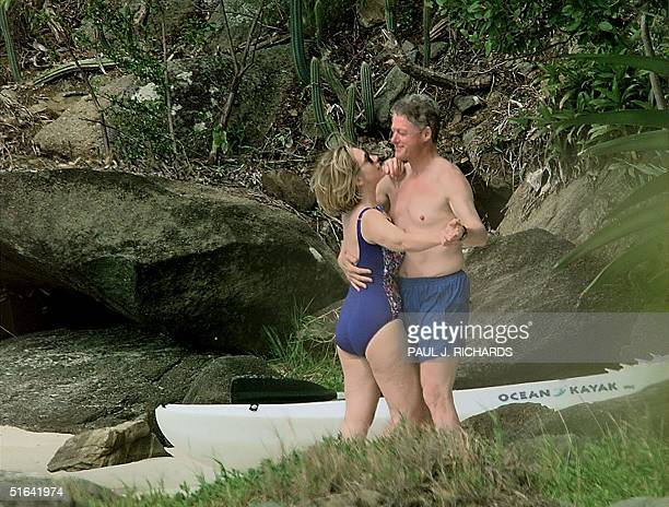 President Bill Clinton and First Lady Hillary Clinton dance on the beach of Megan Bay St Thomas US Virgin Islands 04 January shortly after taking a...