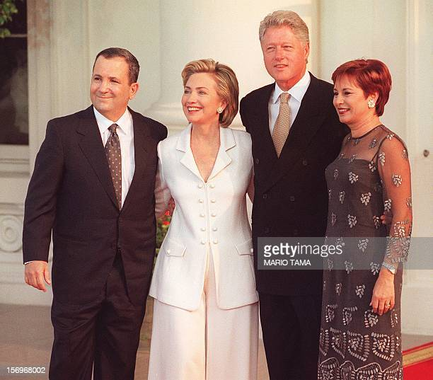 US President Bill Clinton and First Lady Hillary Clinton greet Israeli Prime Minister Ehud Barak and his wife Nava 18 July 1999 at the White House in...