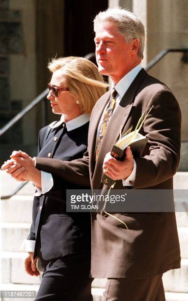 US President Bill Clinton and First Lady Hillary Clinton leave Foundry United Methodist Church 05 March Washington DC after attending Palm Sunday...