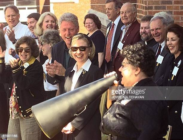 President Bill Clinton and First Lady Hillary Clinton listen to a cheer led by Hot Springs cheerleader Carolyn Wilson at the 33rd Hot Springs High...