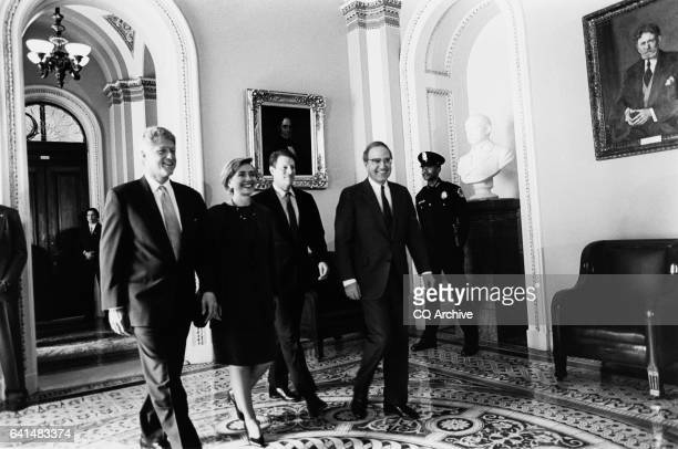 President Bill Clinton and first lady Hillary Clinton Vice President Al Gore and Senator George Mitchell headed to lunch with senators March 23 1994