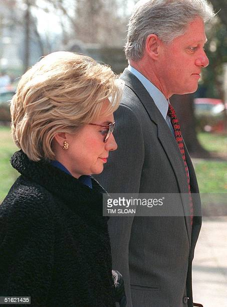 President Bill Clinton and First Lady Hillary Rodham Clinton arrive at Foundry Methodist Church to attend Sunday services 21 February in Washington...