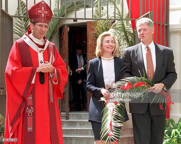 S President Bill Clinton and First Lady Hillary Rodham Clinton exit St Vibiana's Cathedral after attending a Catholic Palm Sunday service with...