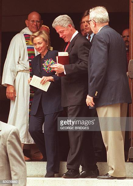 President Bill Clinton and First Lady Hillary Rodham Clinton leave Foundry United Methodist Church in Washington DC after services 16 August to...