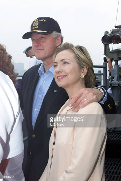 U S President Bill Clinton and First Lady Hillary Rodham Clinton review navy ships from around the world on July 4 2000 on board the USS Hue City...