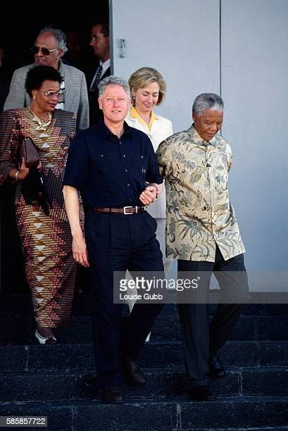 President Bill Clinton and First Lady Hillary Rodham Clinton visit Nelson Mandela and Graca Michel at Robben Island Prison which has housed many...