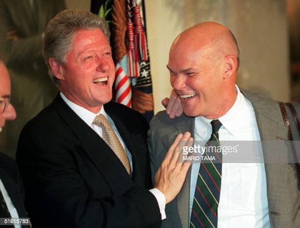 President Bill Clinton and friend James Carville laugh 18 July during a working dinner at the White House in Washington DC Israeli Prime Minister...