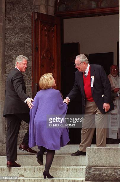 President Bill Clinton and Hillary Clinton are greeted upon arrival at Foundry Methodist Church in Washington DC by William Weber 22 February AFP...