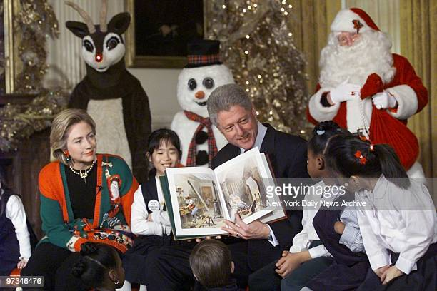 President Bill Clinton and Hillary Rodham Clinton read Twas the Night Before Christmas to a group of 60 children from 13 DC Schools in the East Room...