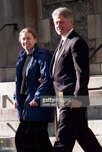 President Bill Clinton and his daughter Chelsea leave the Foundry Methodist Church 17 December in Washington DC The Clintons attended the early...