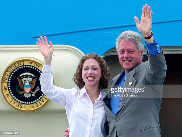 US President Bill Clinton and his daughter Chelsea wave on departure after the G8 Summit at Kadena Air Base on July 23 2000 in Kadena Okinawa Japan