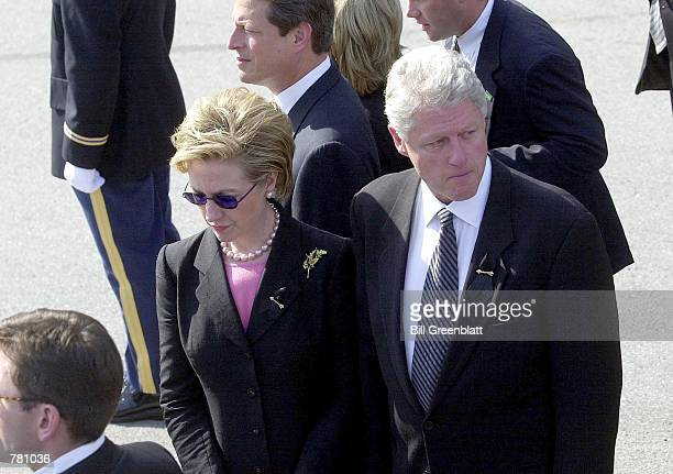 S President Bill Clinton and his wife Hillary Clinton walk to a memorial service for the late Missouri Governor Mel Carnahan October 20 2000 at the...