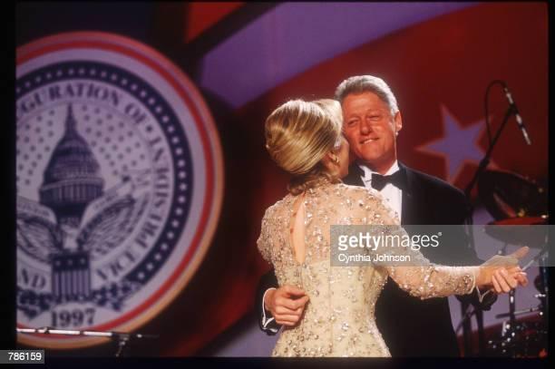 President Bill Clinton and his wife Hillary dance at an inaugural ball January 20 1997 in Washington DC Clinton attended various inaugural balls...