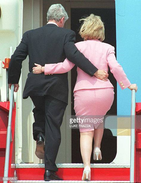 President Bill Clinton and his wife Hillary Rodham Clinton board Air Force One on their way to the Atlanta Olympics after meeting with the relatives...